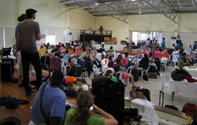 Global Young People's Convocation attendees gather in shelter from typhoon